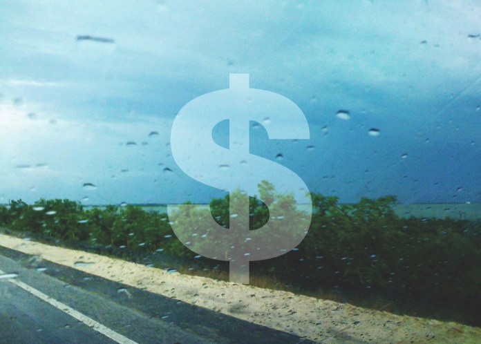 Rate Hike Likely – Wind insurance rates to rise unless legislation passes - A sign in the rain - Insurance