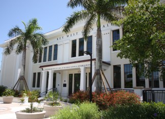 The Great City Manager Debate: Part II - A house with bushes in front of a building - Key West City Hall