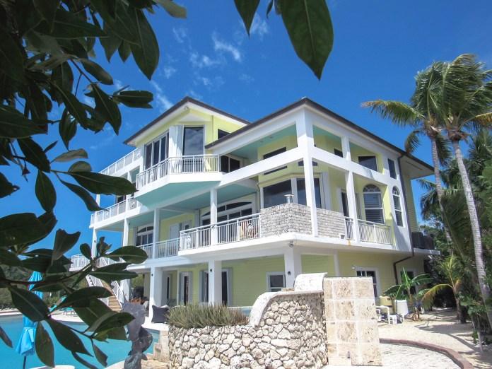 Island Life, Carlos Garcia, Ocean Sothebys - A statue in front of a house - Florida Keys