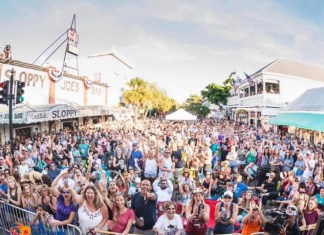 Songwriters Fest Hits Key West with Free Show by Brad Paisley - A group of people standing in front of a crowd - Key West