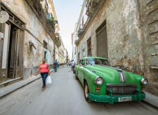 New travel rules make it harder to get to Cuba - A close up of a boy in a green car parked on a sidewalk - Florida Keys
