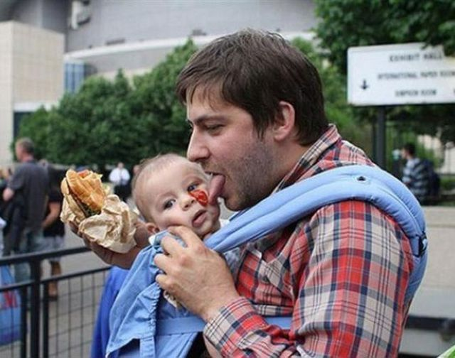 Top Ten Classic Pieces of Dad Advice - A young boy eating a hot dog - Upbringing