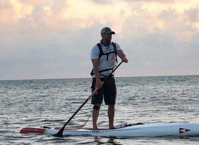 Tavernier man paddling for a cause - A man standing next to a body of water - Florida Keys