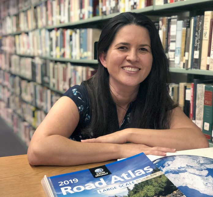 THE NEW LIBRARIAN Lorena Diaz takes the reins of Marathon's public library - A woman sitting at a table in front of a book shelf - Lorena Diaz
