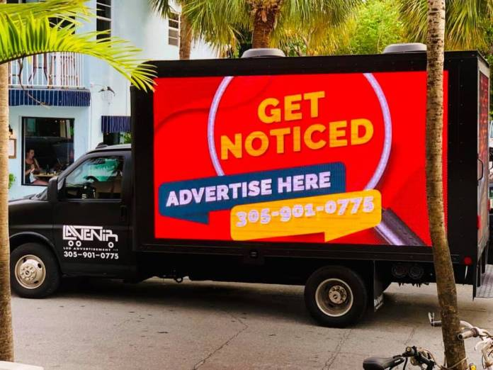 Mobile Billboard Crackdown - A truck is parked on the side of a building - Florida Keys