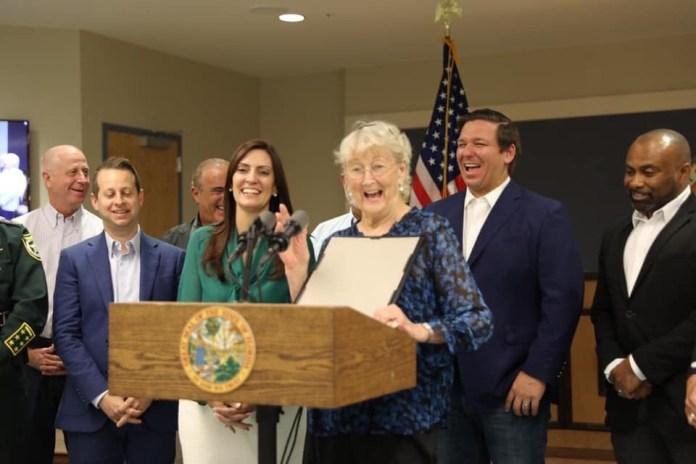 Nuñez visits Keys, recounts legislative victories - Jared Moskowitz, Jeanette Núñez, Ron DeSantis posing for the camera - Public Relations