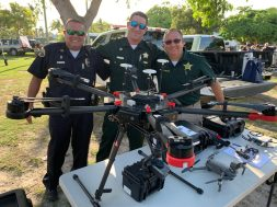 The officers of the Sheriff's Department shows off the latest drone.