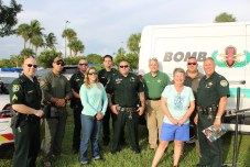 COMMUNITY PARTNERS – Family, food and fun with first responders - A group of people posing for a photo - Car