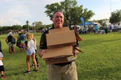 COMMUNITY PARTNERS – Family, food and fun with first responders - A group of people standing on top of a grass covered field - iT'Z