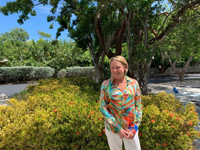 PROMOTED! – Scuderi excelling - A man standing in front of a tree - Florida Keys