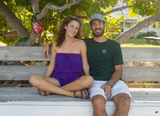Keys couple uses art to inspire others, protect nature - A man and a woman sitting on a bench posing for the camera - Florida Keys