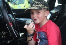 TOP COPS – National Night Out draws a crowd - A little boy wearing a helmet sitting in a car - Car