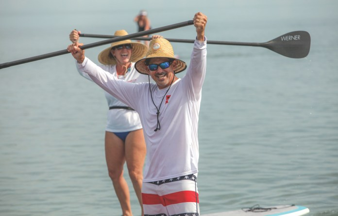 Poker paddle set for Sept. 7 - A woman rowing a boat in the water - Sea kayak