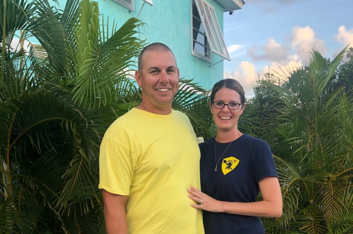 Foster parents talk about their experience - A man standing in front of a palm tree - Palm trees