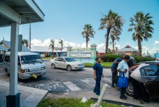 Keys Weekly photographer documents Bahamas plight - A group of people standing in a parking lot - Luxury vehicle