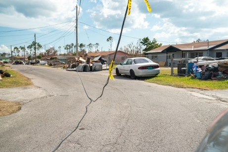 Keys Weekly photographer documents Bahamas plight - A car parked on the side of a road - Florida Keys