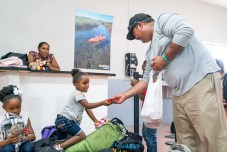 Keys Weekly photographer documents Bahamas plight - A group of people in a room - Florida Keys