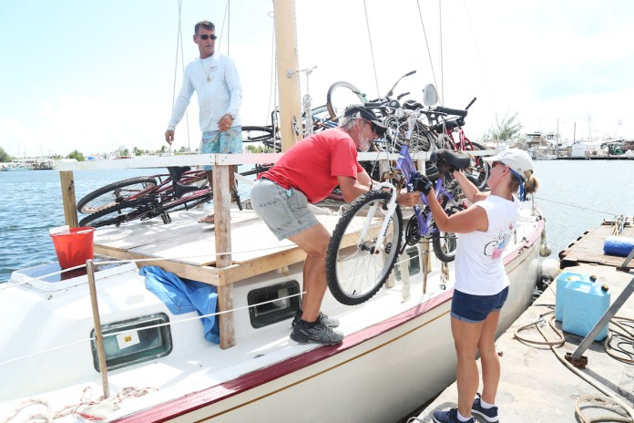 MORE HELP ON THE WAY – Conch Republic Navy sends relief to Bahamas - A group of people on a boat - Sail