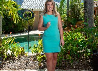 Ally Kelley realtor - Melissa Lee standing on a sidewalk - Dress