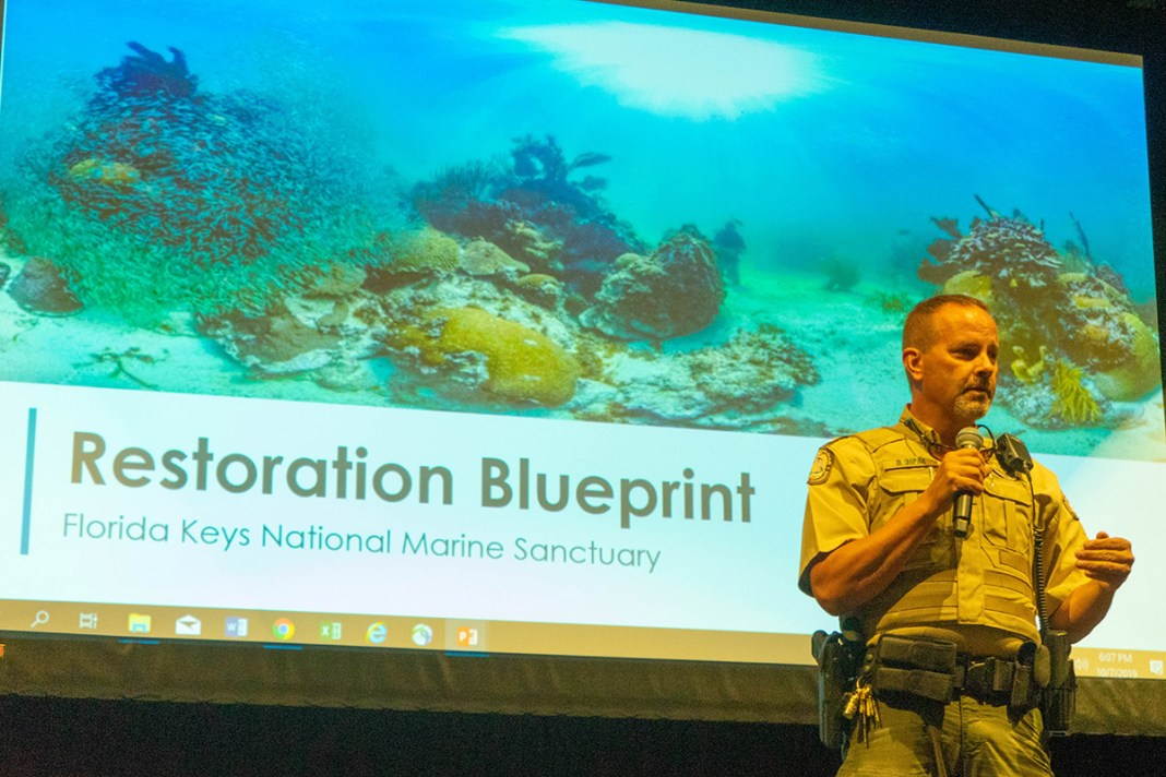 Sanctuary holds info session, Q&A in Upper Keys - John Kelcher standing in front of a television - Performance-based logistics
