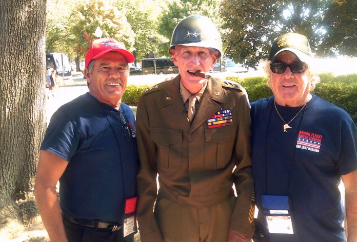 Capt. Skip tours nation's capital with fellow vets - A couple of people that are standing together in uniform - Car