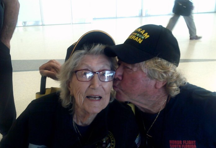 Capt. Skip tours nation's capital with fellow vets - A man and a woman taking a selfie - Glasses
