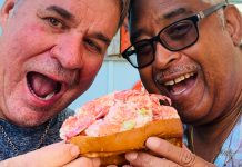 Rolling for a Cause – Local Lobster Roll-Eating Contest benefits Bahamas. - A man eating a sandwich - Eating