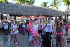 PINK ARMY – Inaugural bra walk in Key Largo sees large support - A group of people standing in front of a crowd posing for the camera - Public space