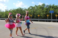 PINK ARMY – Inaugural bra walk in Key Largo sees large support - A little girl walking down the street - Long-distance running