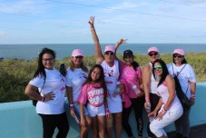 PINK ARMY – Inaugural bra walk in Key Largo sees large support - A group of people posing for the camera - Social group