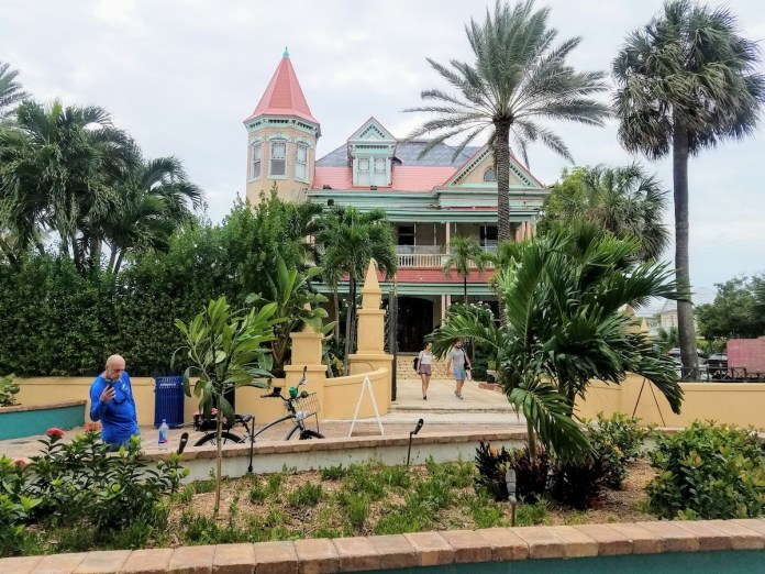 OFF THE PATH KEY – WEST'S SOUTHERNMOST HOUSE IS MORE THAN A MANSION - A group of people walking in front of a building - Palm trees