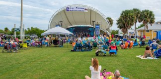 Missed it? Coral Head music fest entertains crowd - A group of people in a field - Triathlon