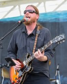 Missed it? Coral Head music fest entertains crowd - A man holding a microphone - Guitar