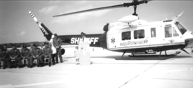 FORMER SHERIFF RICK ROTH LEAVES LASTING LEGACY - A group of people riding on the back of a truck - Helicopter rotor