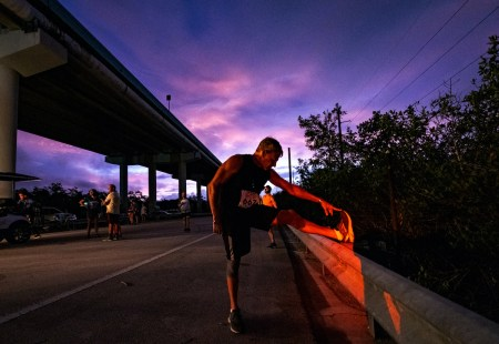 A man stretching on the road