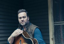 One of music's biggest stars plays Key West tonight - Lee Brice standing in front of a building - Lee Brice