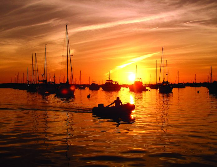 Celebrating 20 years: Marathon's roots traced back to property rights - A sunset over a body of water - Red sky at morning