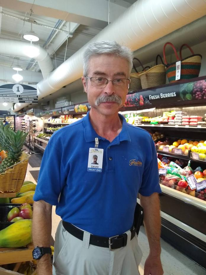 'I'm a Working Man' – Businesses, adults with disabilities benefit from jobs - A man standing in front of a store - Grocery store