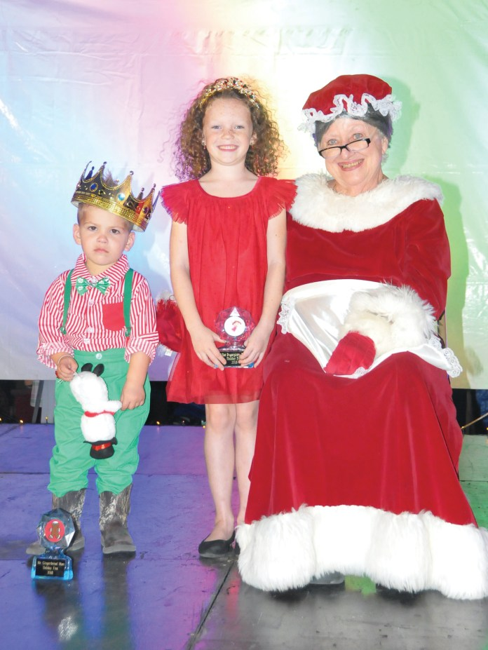 WINTER WONDERLAND–Snow, Santa and sweets at Holiday Fest - A group of people wearing costumes - Christmas Day