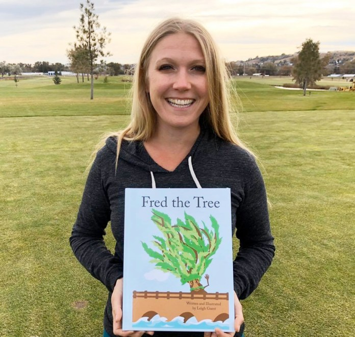 Book 'Fred the Tree' delights young and old - A person holding a sign posing for the camera - T-shirt