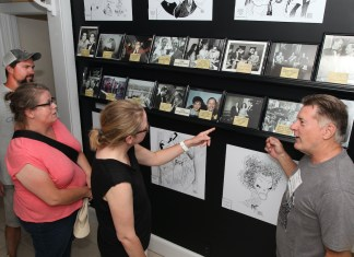 Tennessee Williams Museum opens new exhibit – Rare photos show playwright's personality - A group of people standing in a room - Art exhibition
