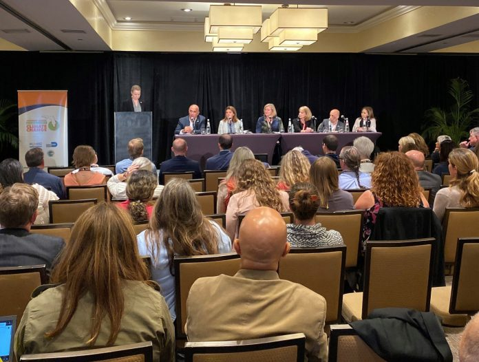 Florida Keys hosts climate summit - A group of people sitting at a table - Academic conference