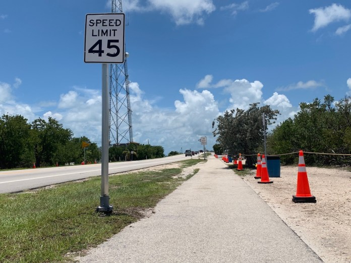Council acts on Fills, Anne's Beach opens - A sign on the side of a road - Traffic sign
