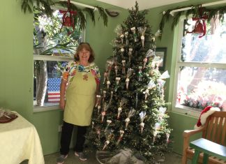 Holiday craft market brings 40-plus vendors - A little girl standing in front of a window - Christmas tree