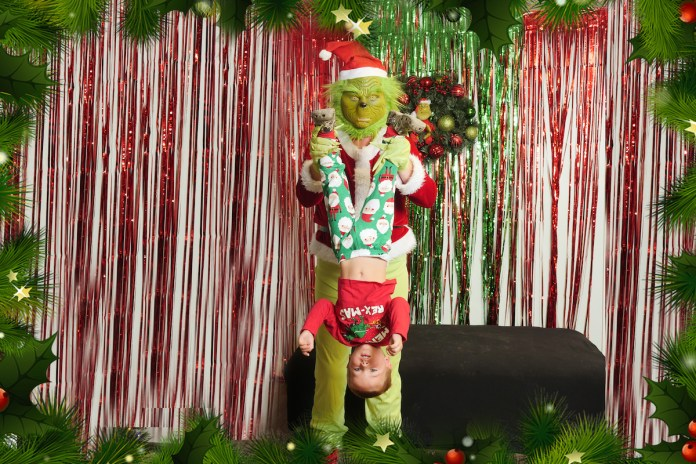 WINNER – Keys Holiday Photo Contest - A person standing next to a christmas tree posing for the camera - Christmas tree