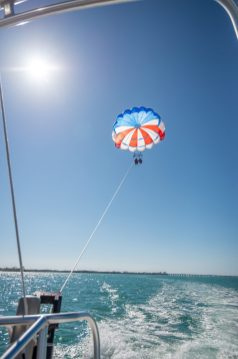 GLIDING INTO SEASON LIKE … - A boat in the water - Parasailing