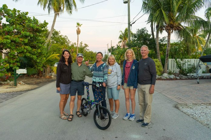 BUILDING, SUPPORTING AND EXCELING IN 2019 - A group of people riding on the back of a bicycle - Florida Keys