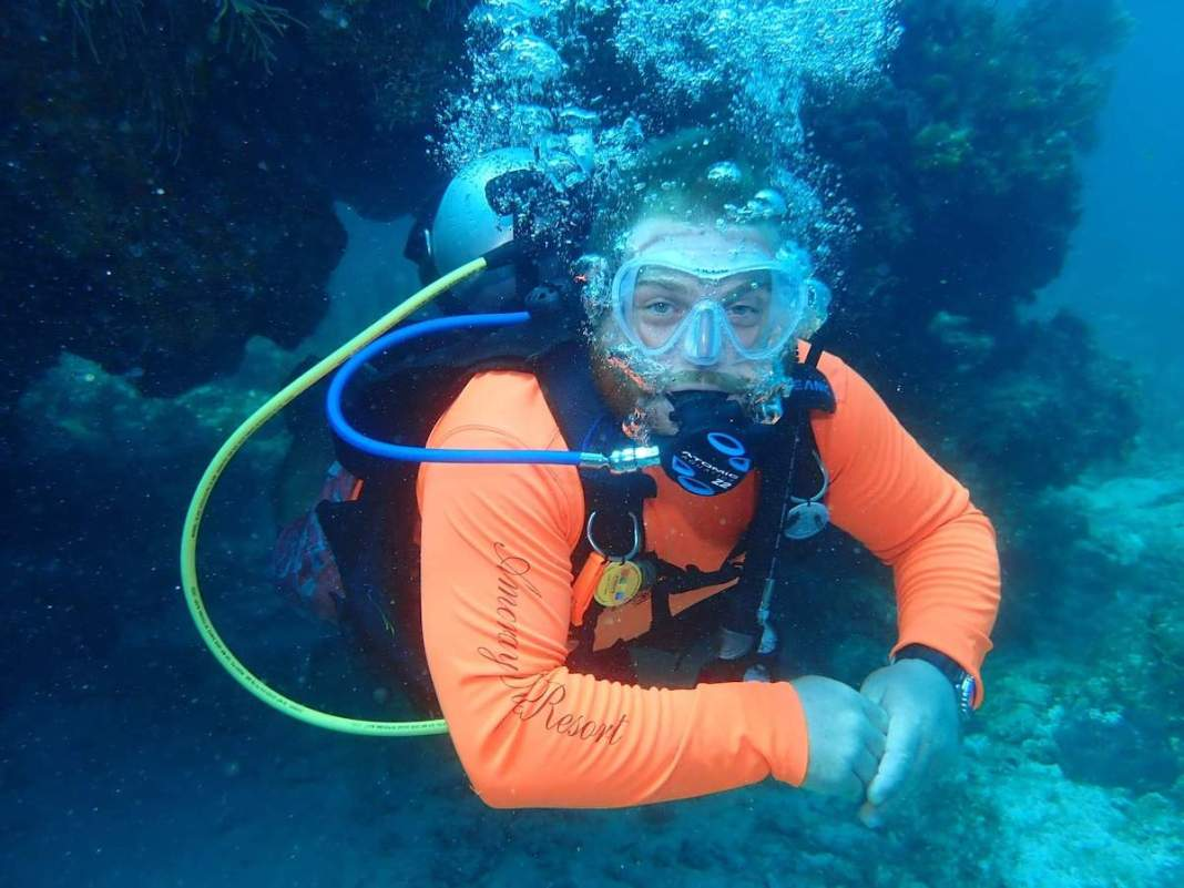 """""""I don't like that Key Largo will be made into a no anchor zone, but I think it's necessary."""" - A man swimming in the water - Free-diving"""
