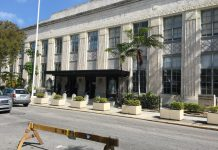 Courthouse parking, sidewalk dining, city approves both - A bus driving down a busy street - Duval Street