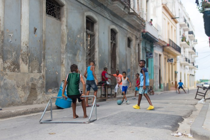 Learn about how to travel to Cuba at Marathon Library talk - A group of people walking on a sidewalk - Street